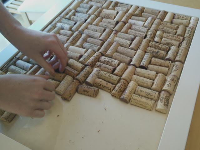 Arrange the corks on the board