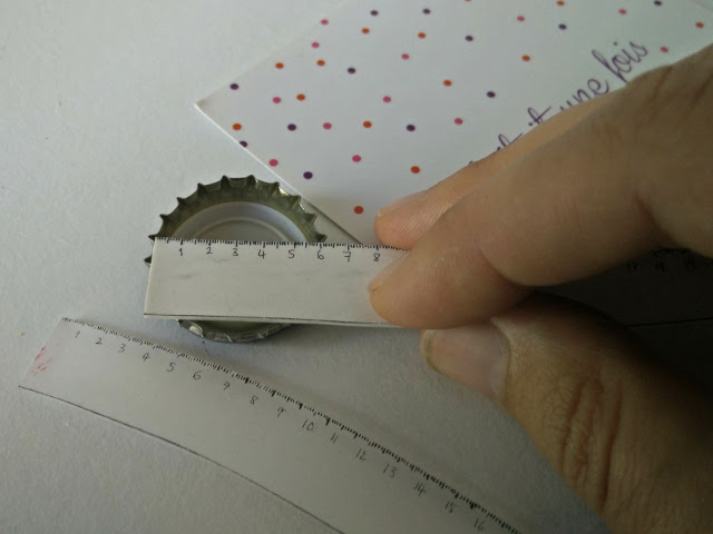 Using the shrink plastic ruler to measure a bottle top