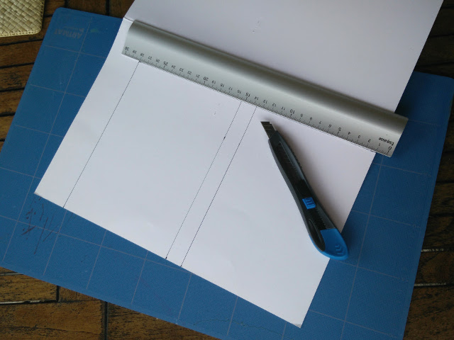 Cutting a piece of card to fit the book cover