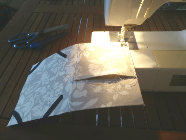 Sewing the pocket and elastic to the card