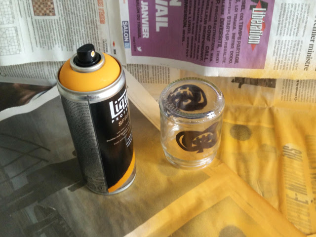 Spray paint the outside of the jars