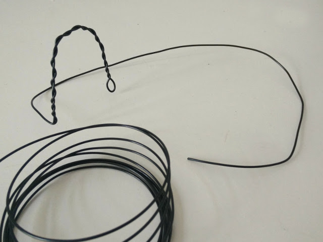 Twist the wire together to make a handle
