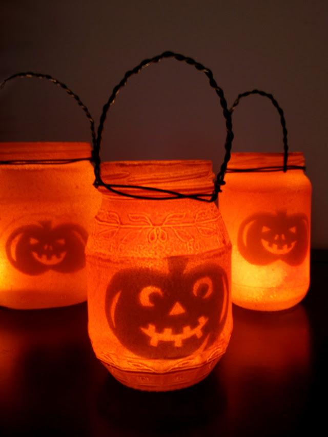 Halloween lanterns made from recycled jam jars