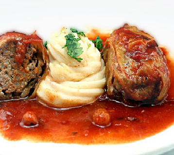 Amazing Old-Fashioned Stuffed Cabbage Rolls. Tender leaves of cabbage stuffed and rolled with beef, garlic, onion and rice, simmered in a rich tomato sauce.