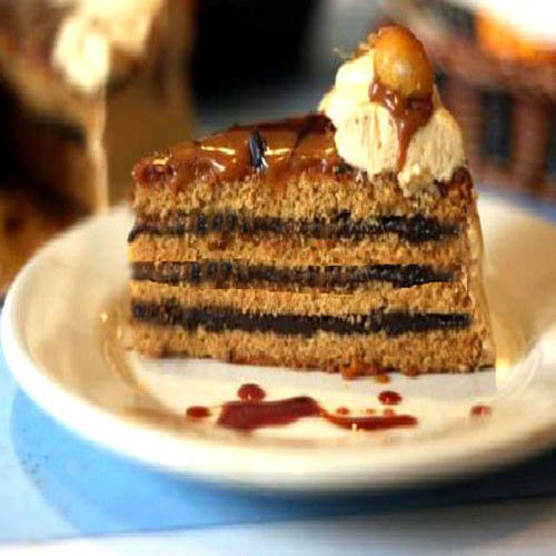 Tender and Moist Caramel Cake with Caramel Brown Butter Frosting and Hot fudge Filling. Gluten-Free version too!