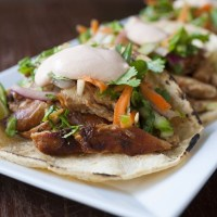Korean BBQ Chicken Tacos with Coleslaw and Sriracha Sour Cream