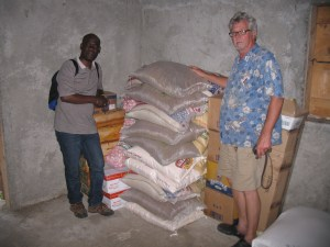 Fr. Gracia and Bob inspecting food for Chateau.