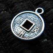 lucky coin charm
