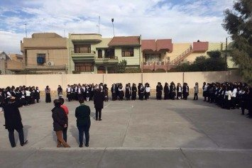 Iraqi teachers' campaign strives to end violence against women