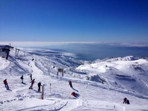 Mount Hermon, on the border of the Israeli-controlled Golan Heights, Lebanon and Syria.  A couple of weeks after the author skied there, the ski resort was evacuated after a nearby IDF vehicle was struck by an anti-tank missile fired by Hezbollah. PC: Eddie Grove