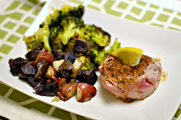 Whole30 compliant dinner of seared tuna steak with a lemon pepper butter sauce, roasted herb potatoes and broccoli