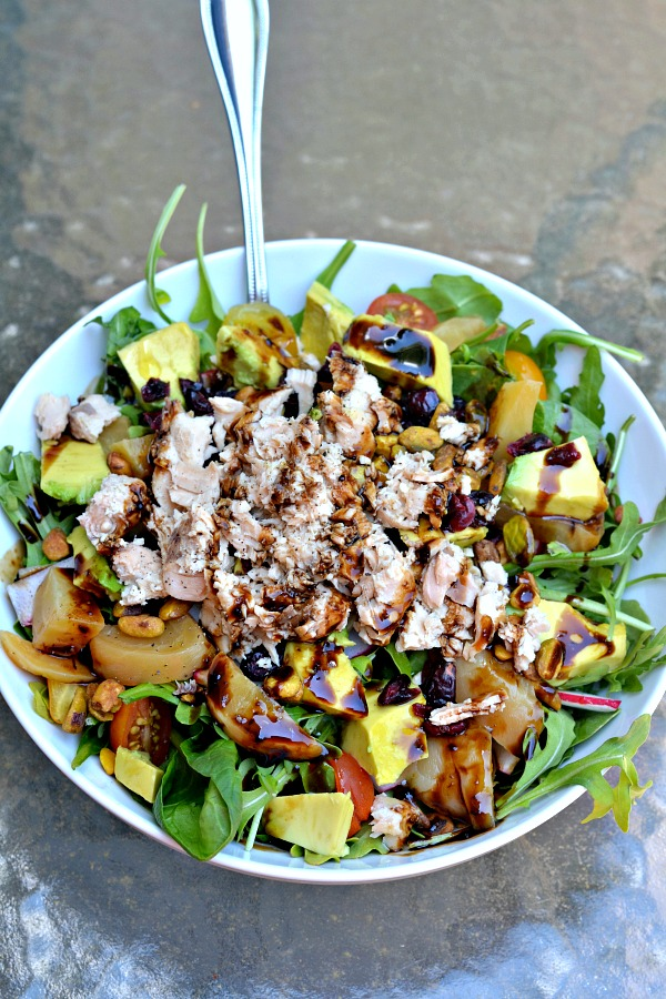 Salad with canned salmon, veggies, fruit and nuts