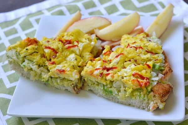The most addictive avocado toast ever. Avocado, sauerkraut and scrambled eggs on sourdough.