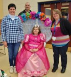 Emily poses with her parents, Kerry, left, and Tim Graver, and Tammy Martelle, who made Emily's dress.