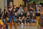 """Stephanie Grace sings """"Loser"""" at the assembly at Manor Middle School Monday."""