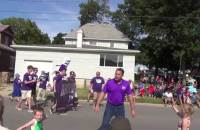 Democrat Rep. Bruce Braley tells Iowa voter he is a farmer at July 4th parade.