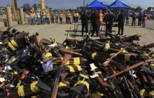 July 30, 2013: Guns to be melted lie in a pile near a news conference at the Los Angeles County Sheriff's Department's 20th annual Gun Melt at the Gerdau Steel Mill in Rancho Cucamonga, California. (Photo: Reuters)