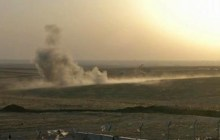 This image made from AP video shows smoke rising from airstrikes targeting Islamic State militants near the Khazer checkpoint outside of the city of Irbil in northern Iraq, Friday, Aug. 8, 2014. The Iraqi Air Force has been carrying out strikes against the militants, and for the first time on Friday, U.S. war planes have directly targeted the extremist Islamic State group, which controls large areas of Syria and Iraq.(AP Photo via AP video)