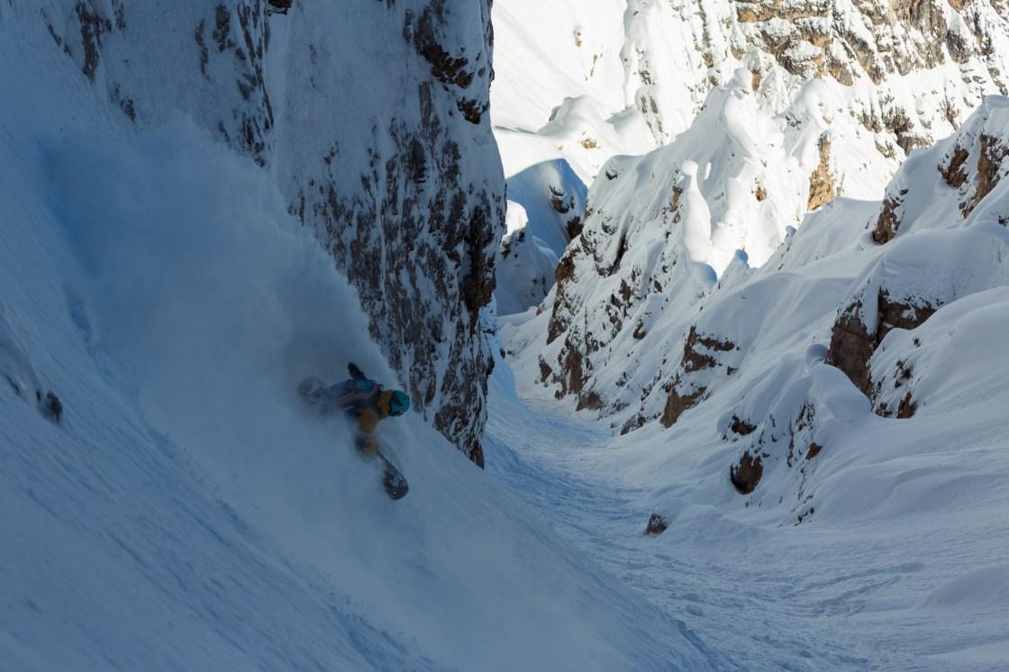 Bibi Pekarek drops in to a chute in the Dolomites