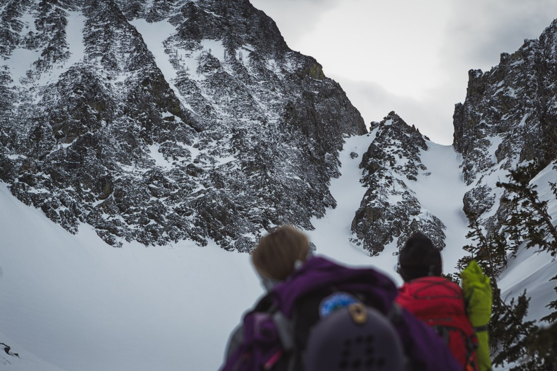 Neil Provo and Michele Manning eye up chutes in the Cascades, Holden Village, WA