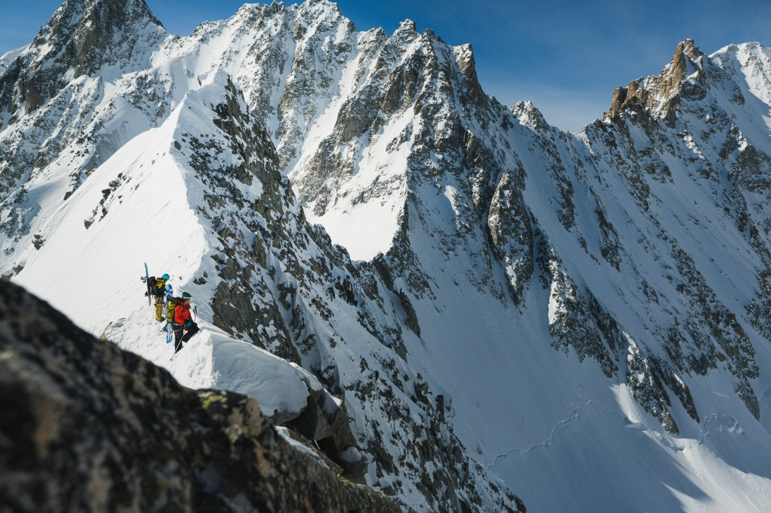 Liz Daley and Bibi Pekarek look across the Glacier de Saleina with the Aguille de l'A Nueve behind.