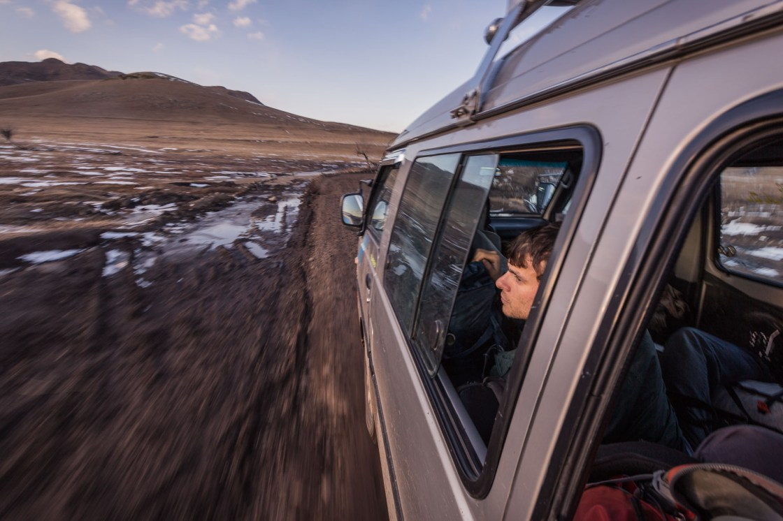 Gregg Treinish riding in a hired van on an ~18 hour drive from Ulaanbaatar to Mörön, Mongolia