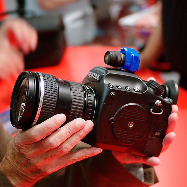 Tiny Pentax DSLRs from a Toy Capsule Machine at Photokina hotshoe