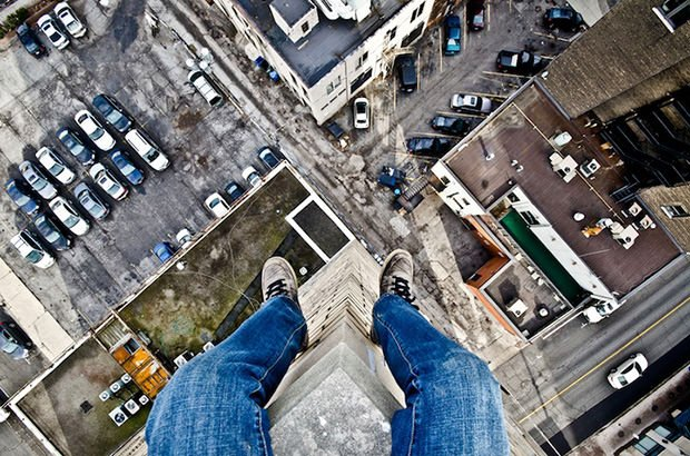 Gutsy Photographer Captures His Own Feet Dangling Off High Ledges dangle1 mini