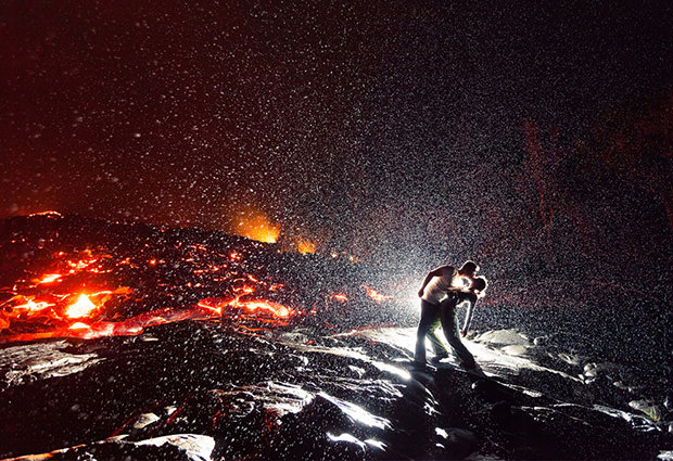 Stunning Photo of a Kiss Over Lava in the Rain volcano mini
