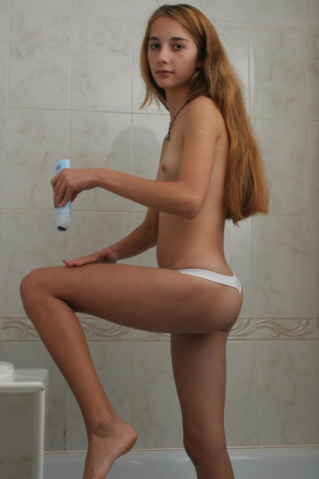Naked girl budding breasts