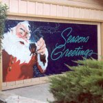 A custom hand painted banner reading Season&#039;s Greetings done in enamel paint