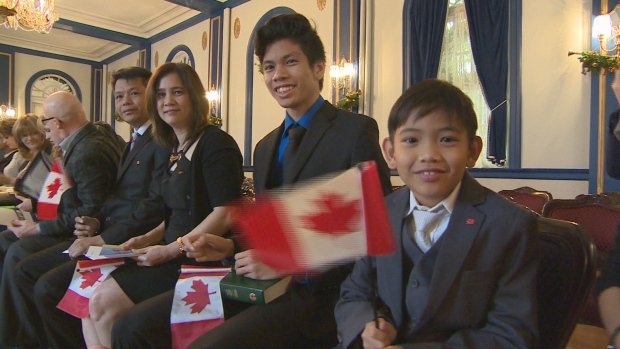 Oyando family at a citizenship ceremony at the Government House in Regina. Photo by Craig Edwards of CBC