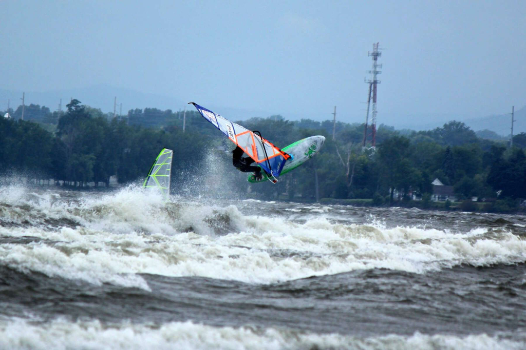 Backside air - Phil Soltysiak CAN 9 Windsurfing on Lac Champlain. Photo by Adam Wojtkowiak.