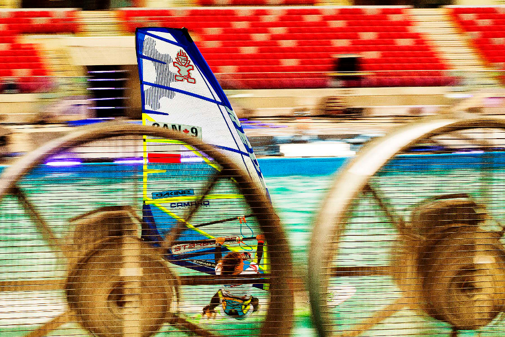 Flying in the pool - Phil Soltysiak CAN 9 Windsurfing at PWA Indoor Stadion Narodowy, Warsaw, Poland. Photo by John Carter.