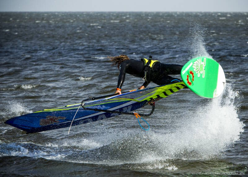 Phil Soltysiak freestyle windsurfing in front of the Island Creek, Avon, house. Pic by Remco Terwal.