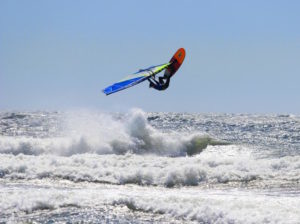 Phil Soltysiak backloops windsurfing in Pistol River Oregon - Photo by Lawrence Stewart
