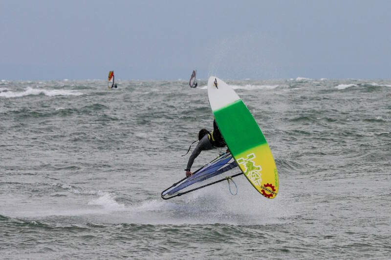 Phil Soltysiak rotates a Burner windsurfing at Sherkston Shores - Photo by Yurii Kuzmin