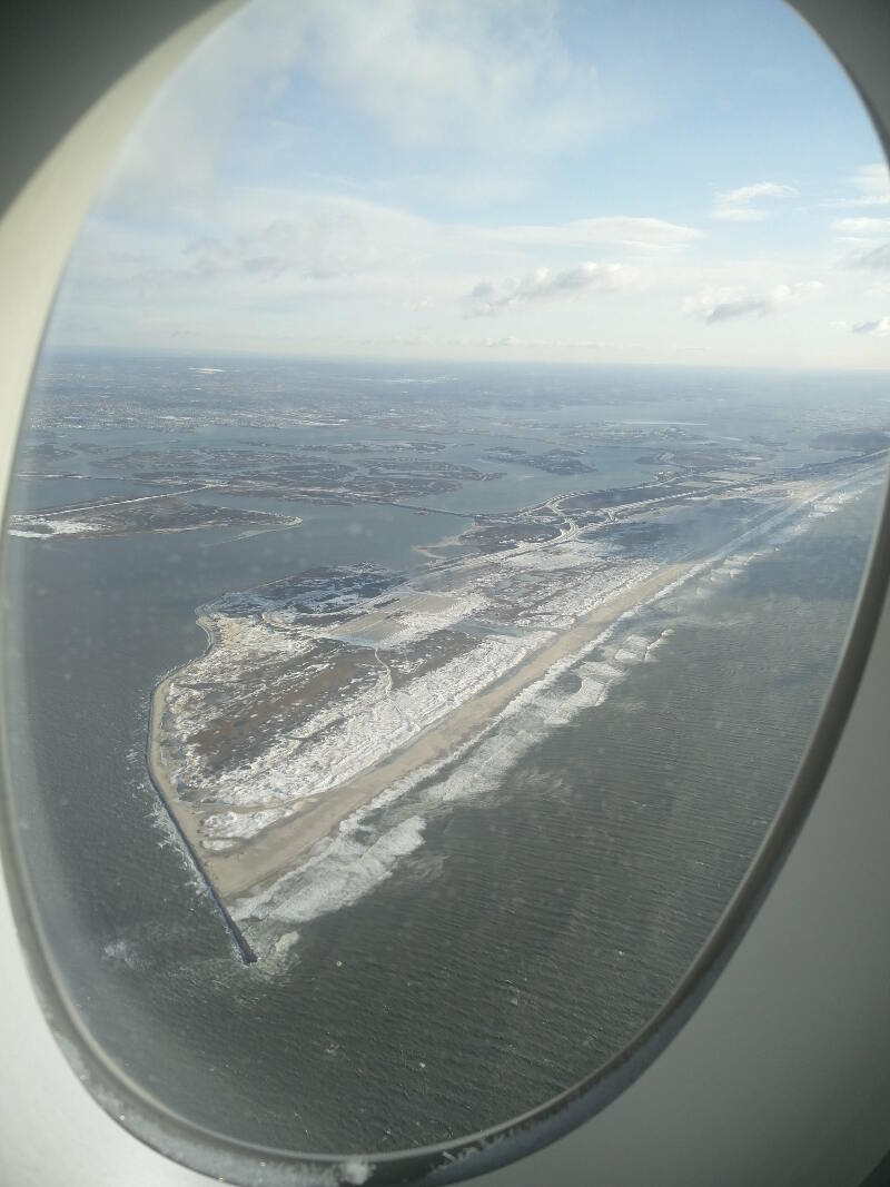 Nice waves and snow flying home over NYC.