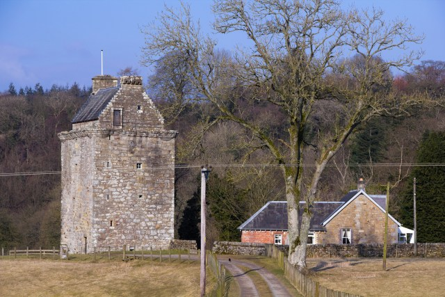 Hollows, the tower house of the Armstrong clan lairds of Gilnockie on the border between England and Scotland. Unretouched see also version with power lines removed from shot.