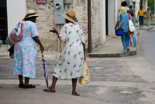 Barbados Holetown St Thomas parish west coast two Bajan ladies typically dressed chat on a street corner