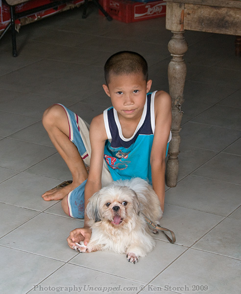 Young Boy with his Terrier in New Sukhothai Thailand