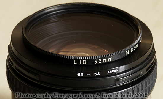 62mm to 52mm Step-Down Filter Ring Adapter on the Lens Which Takes 62mm Filters