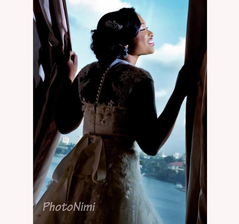 beautiful bride, looking out the window, photonimi