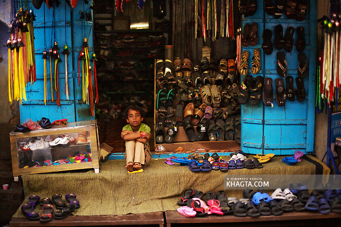 A child waiting for a customer at his shoe shop in Pushkar. Holy town of Pushkar, 14 kms from Ajmer is famous for its annual camel fair held in the autumn. With a scared lake, old temples and roof top restaurants, its a major tourist attraction attracting mostly foreign tourists. Pushkar also offers a great variety of delicious food. The town that got famous by its colorful camel fair is a very old religious place for Hindu pilgrims. (Himanshu Khagta)