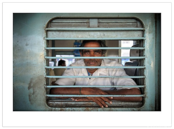 A man looks out of a train window at Nampally Railway Station in Hyderabad, India (Ian Mylam/© Ian Mylam (www.ianmylam.com))