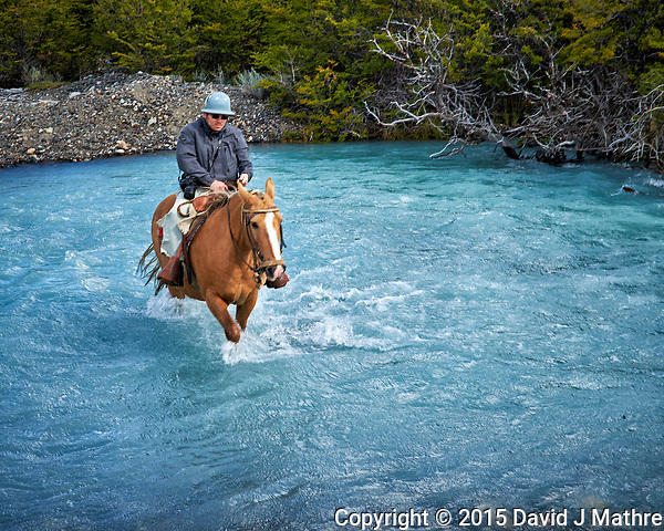 Crossing a glacier stream on a horse in Patagonia. Image taken with a Fuji X-T1 camera and  Zeiss 32 mm lens (ISO 200, 32 mm, f/11, 1/80 sec). (David J Mathre)