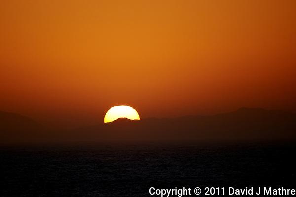 Sunrise over Isla Cedros Mexico. Image taken with a Nikon D3s and 70-300 mm VR lens (ISO 200, 300 mm, f/5.6, 1/1250 sec). (David J Mathre)