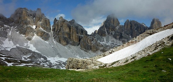 Clouds rolling over the Italian Dolomites just as the snow melts and the grass reappears. (Abigail King)