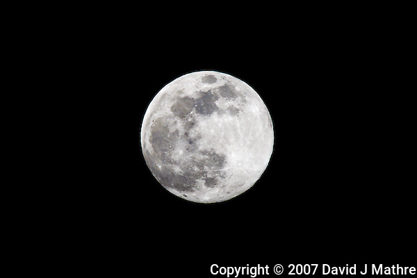 Full Moon over Kona International Airport  Image taken with a Nikon D300 and 80-400 mm VR lens (ISO 200, f/8, 1/250 sec). (David J Mathre)