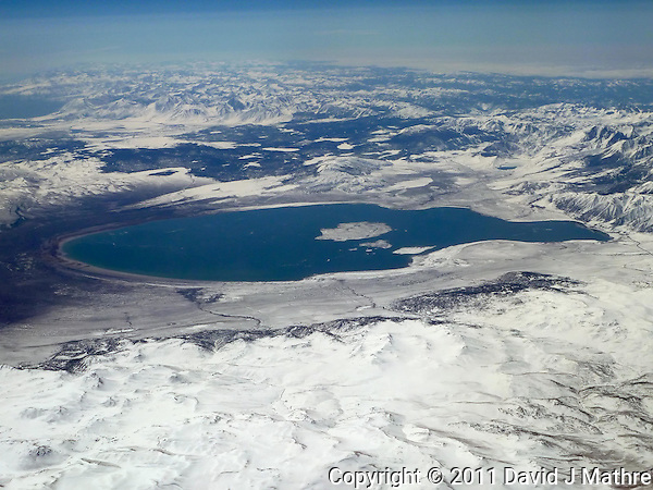 Aerial View of Mono Lake from 36,000 feet and 27 miles during a commercial flight from San Francisco to Newark. Image acquired with a Leica V-Lux 20  (ISO 80, 9.7 mm, f/6.3, 1/800 sec). Processed: Capture One 6 Pro (raw conversion, haze reduction), Photoshop CS5, Focus Magic (sharpening), Nik Define 2 (noise reduction), Photoshop CS5 (save for web). (David J Mathre)